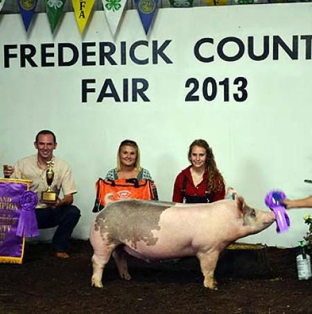 Ashten Sfarnas with the Grand Champion Market Hog at the Frederick County Fair
